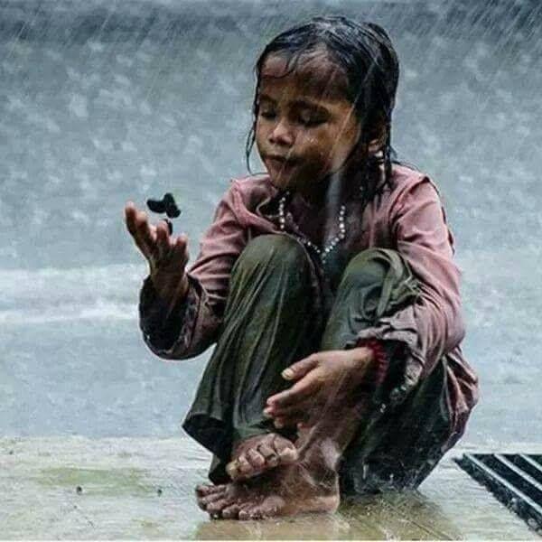 Southeast Asian girl playing in the rain