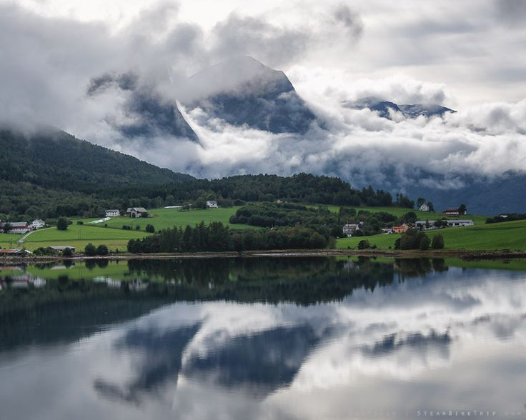 5-year bike trip, day 73: Sometimes after rainfall in the mountains, the water immediately rises back up as fog and clouds. (Eidsbygda, Norway)