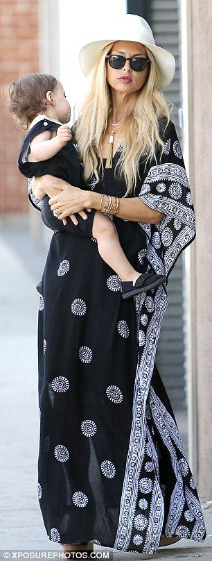Another day, another caftan! Rachel Zoe donned one of her many b&w caftans for a fun-fille...