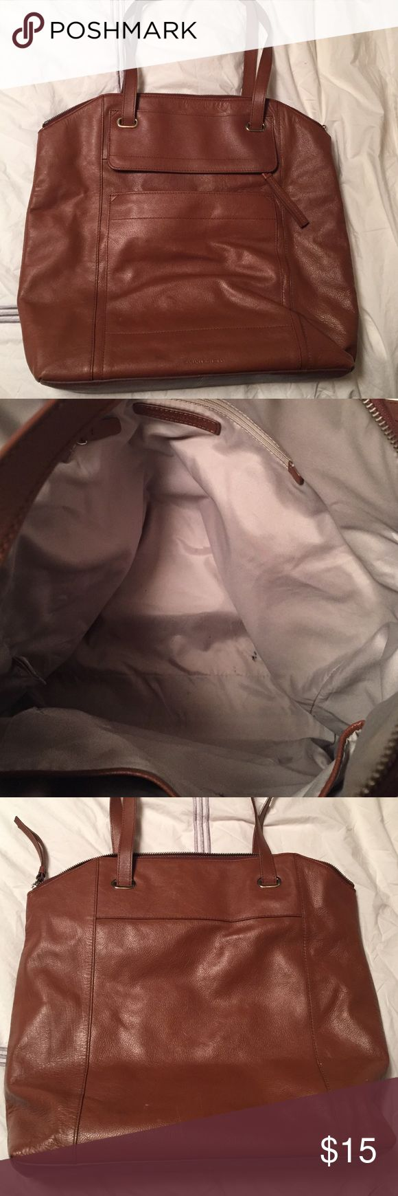 Banana republic leather tote bag Sturdy bag with top zipper, and 2 outside pockets. Inside lining has some marks otherwise great condition. Has 2 cell phone pockets inside. Some marks on outside as well pictured. Loved this bag! Banana Republic Bags Totes