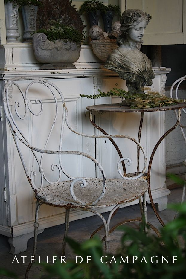 Gorgeous wrought iron chair... so homey. I am thinking it has seen many years on that porch!