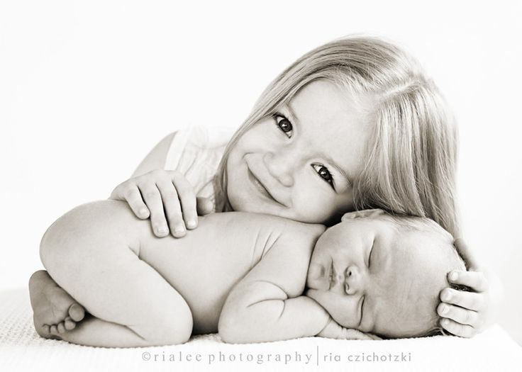 Newborn and sibling pose