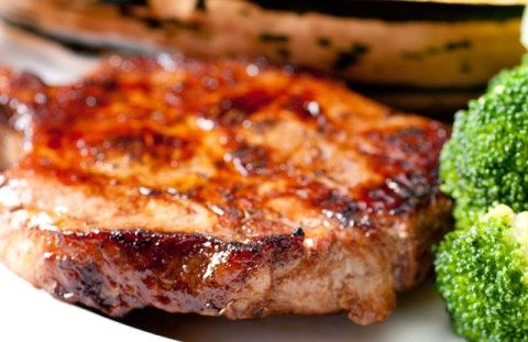 Baked pork chops recipe that is easy to make and absolutely delicious. Bakes in the oven with a brown sugar sauce and onions. A must try recipe!