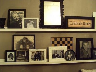 Ashley's Thrifty Living: The Shelves Behind the Couch....old photo display