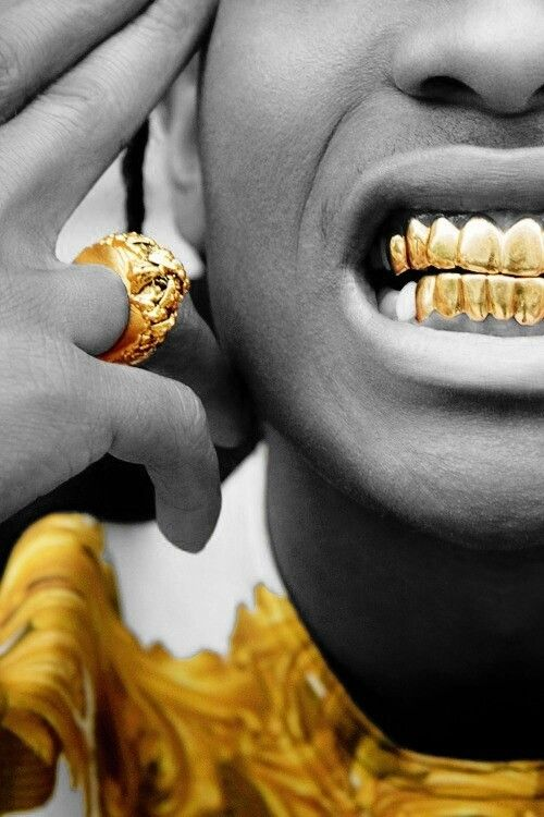I like the contrasting colours of the gold teeth and ring compared to the rest of the black and white picture