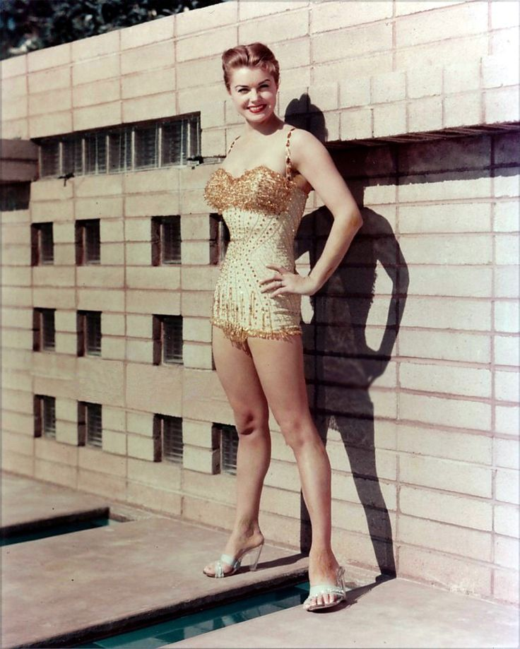 """Esther Williams (August 8, 1922 - ) is a United States competitive swimmer and 1940s and 1950s movie star. Known as """"America's Mermaid,"""" she was famous for her musical films that featured elaborate performances with swimming, diving and """"water ballet,"""" which is now known as synchronized swimming. Gorgeous Vintage Swimsuits."""