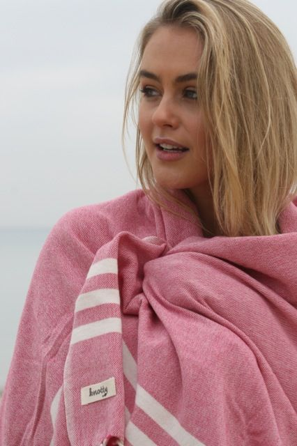 Beautiful Steph Claire Smith staying warm between takes on set with her Knotty lambswool blanket.