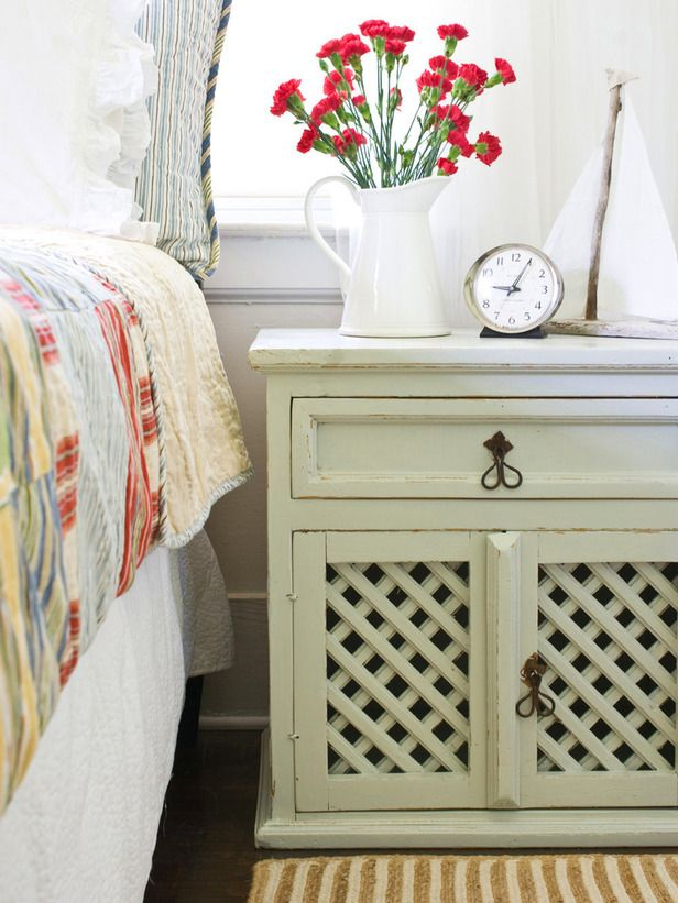 Mix Styles for a Personalized Look    The distressing on this nightstand, as well as the simple lattice, give it a decidedly shabby chic vibe that mixes well with the preppier madras bedding and stripes in this country bedroom. You don't have to go all out with pink doilies and rose motifs. Shabby chic complements many design styles.