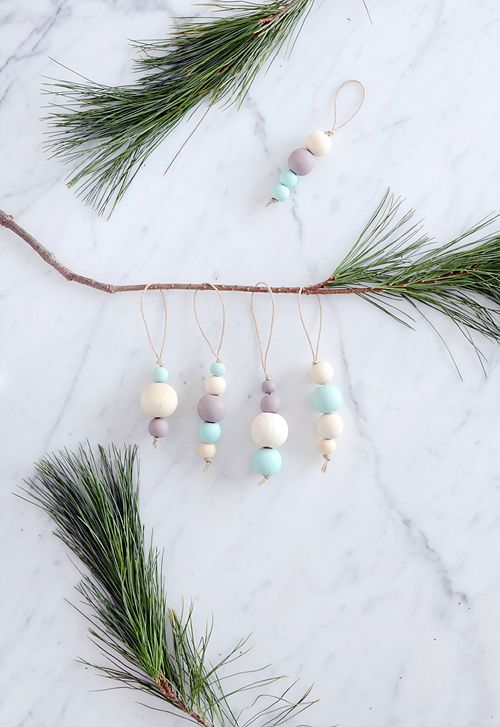 Looking for a simple and modern ornament for your tree this year? Try making these beautiful, wooden painted beads.