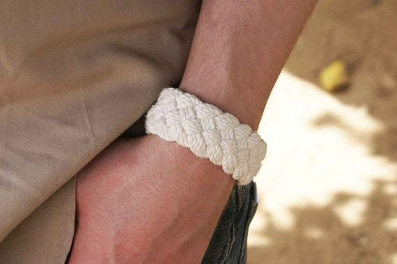 This wider traditional classic turks head knot sailor bracelet is made with a single piece of 100% cotton cable cord. The five part double diamond weave design is a nice proportional shape. Perfect for all season wear. Adds a touch of nautical stye to a day the beach or office. Slips on over your hand and settles on your wrist comfortably. All cotton construction is flexible and soft. Wetting the bracelet in pool or shower will cause it to shrink on your wrist. No hardware, clips, or snaps…