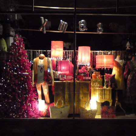 Fixtures; tables  Props; Functional & Decorative Lighting; Foot lights, spot lights from above and below Color; Hot pink Shape; Footlights are placed behind the display to highlight the silhouette of each item Balance; Informal Emphasis; The table display