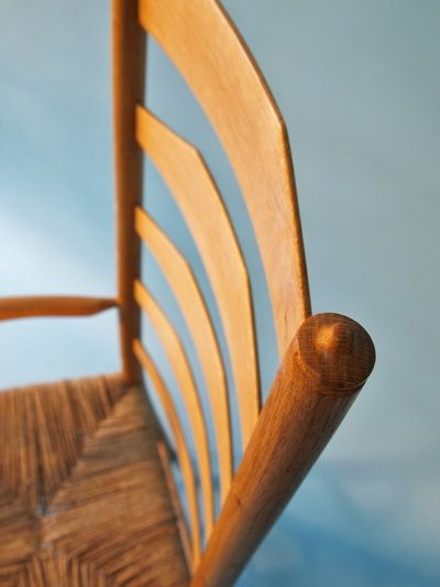 Clisset chair in English ash, showing the hand-shaped back slats