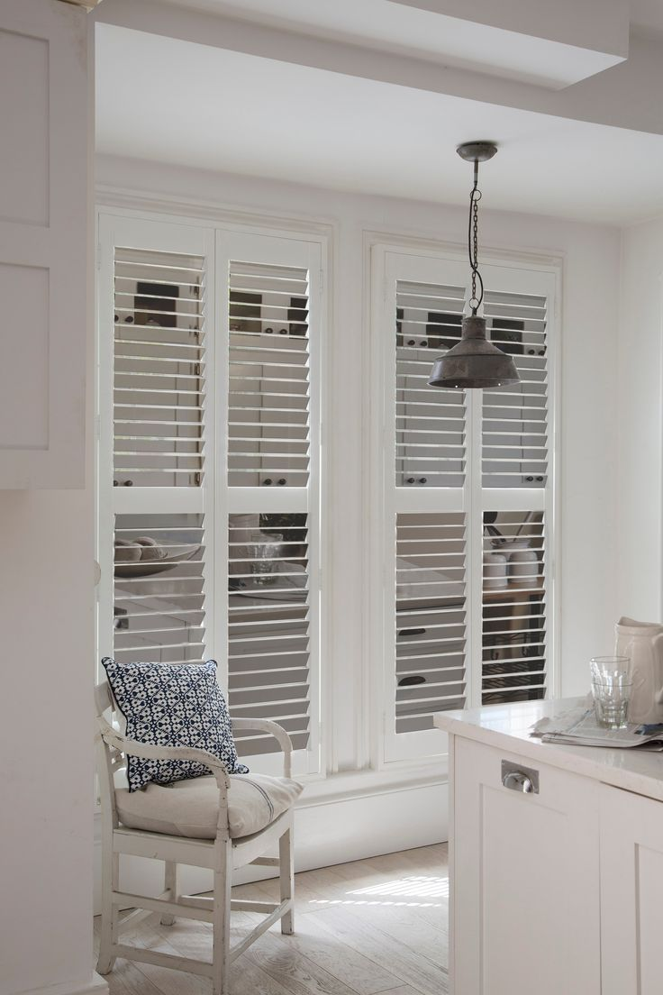 Give a modern twist to a kitchen with Silver Luxaflex Mirror Shutters.  #mirror #shutters #windows #interiors #kitchen #morning room