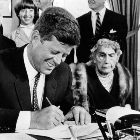 JFK and Mrs. Wilson.