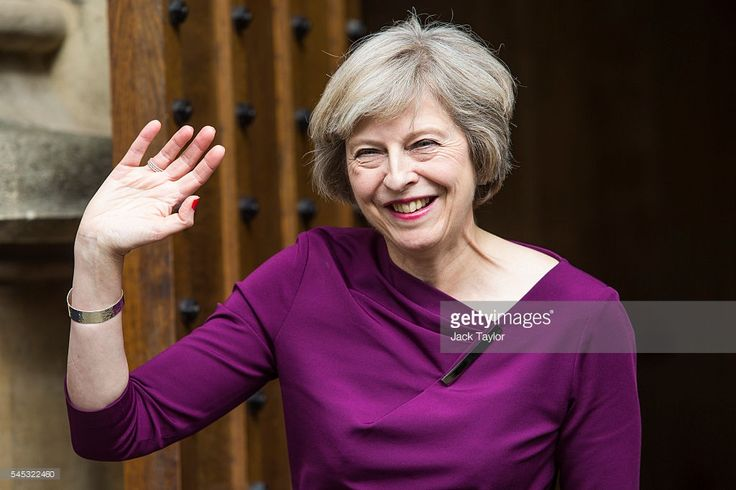 British Home Secretary and Conservative leadership contender Theresa May waves outside the Houses of Parliament on July 7, 2016 in London, England. Theresa May has the backing of 199 fellow MPs after the second ballot for the leadership of the Conservative Party. Receiving 84 votes, Andrea Leadsom MP joins May on the shortlist presented to the Conservative Party members and Michael Gove was eliminated with 46 votes.