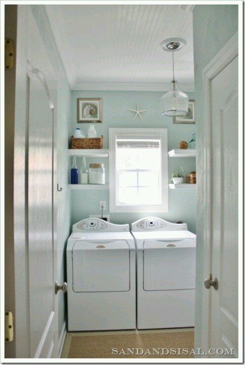 Blue beachy bright white laundry room