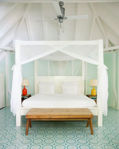 May 2013 Issue - A four-poster bed with mosquito netting at La Banane St Barths