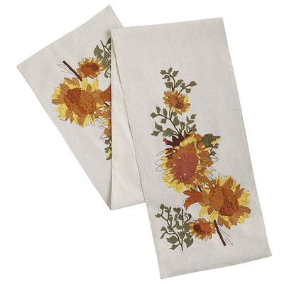Thanks to their unique ability to provide both nourishment and vibrance, sunflowers make a great addition to any tabletop. And since every well-dressed table needs a runner, let's start with ours. Crafted by hand in a cozy linen-blend fabric, each is unique. Pair one with our coordinating sunflower dinnerware, or mix and match with spicy solids.