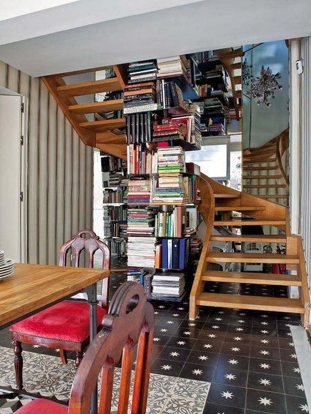 What could be better than a winding staircase that revolves around a tower of books?