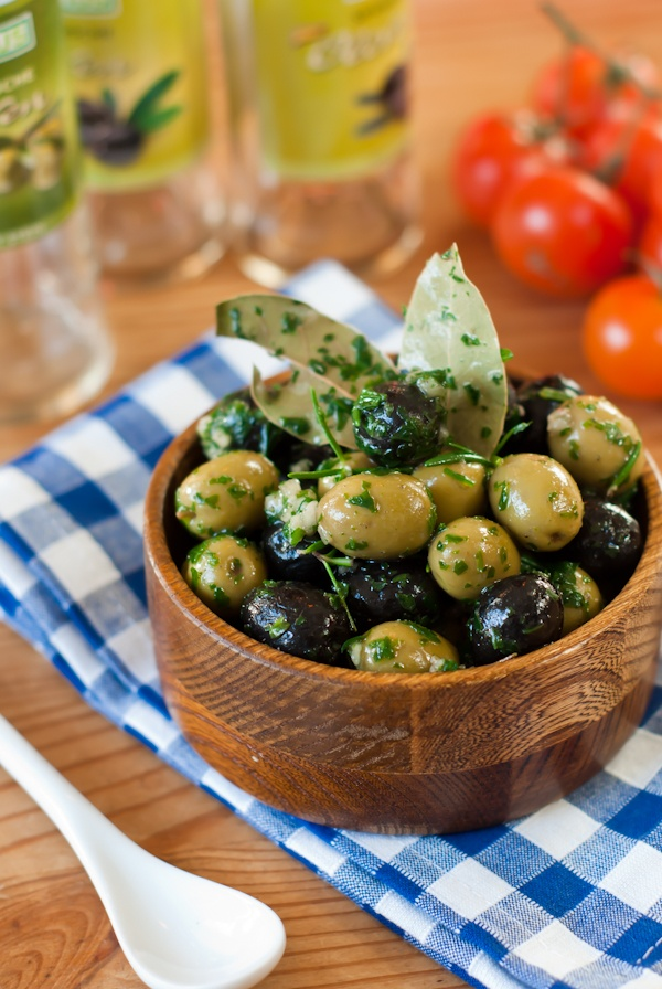 Seasoned olives - exchange olive oil for the vegetable oil in the recipe and up your seasoned olives game!