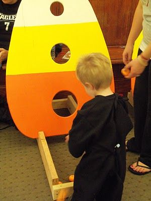 The kids will like this bean bag toss-Use a refrigerator box and cut out a candy corn, or make it out of wood for something you could use every year.  Easy! Get more info here  HERE