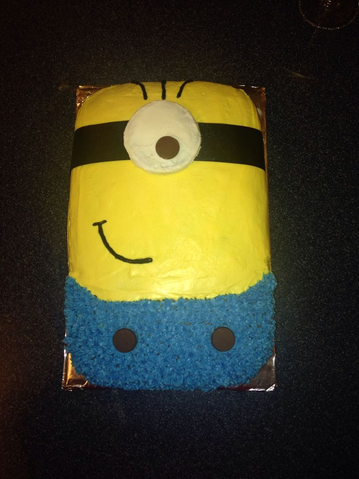 Minion cake: rounded 9 x 13 cake pan, Hershey kisses as buttons on the pants, large York Peppermint Patty topped with white frosting and a Hershey kiss for the eye, black ribbon as head band, and black frosting in can with frosting tips for lips and hair. Very easy to make!