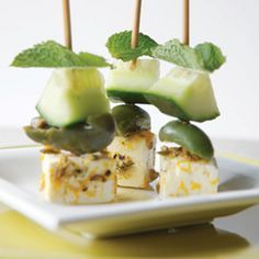 Marinated feta, olives and cucumber appetizers.