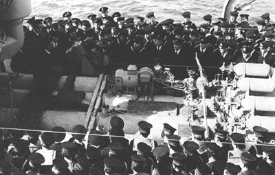 The crew of the HMCS Athabascan being addressed by Vice-Admiral Percy Nelles in April 1944. In a few dozen hours the ship would be sunk by a U-boat.