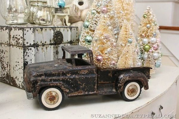 rusty toy truck carrying brush christmas tree