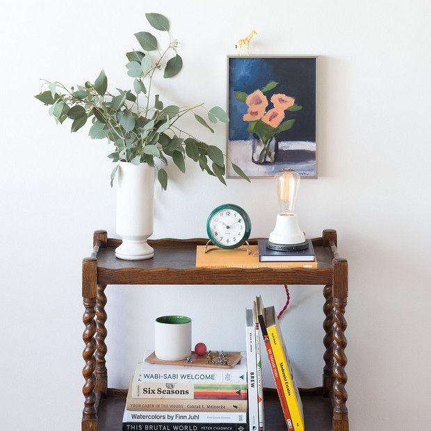 eclectic bedroom vignette with retro alarm clock