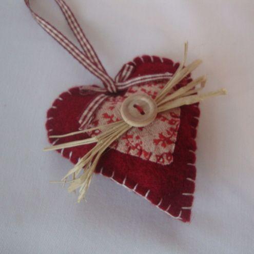 http://www.folksy.com/items/2245917-Handmade-Shabby-Chic-Felt-Christmas-Decorations