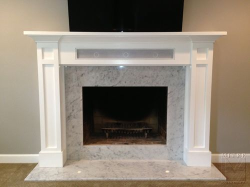 Center channel inside fireplace mantle