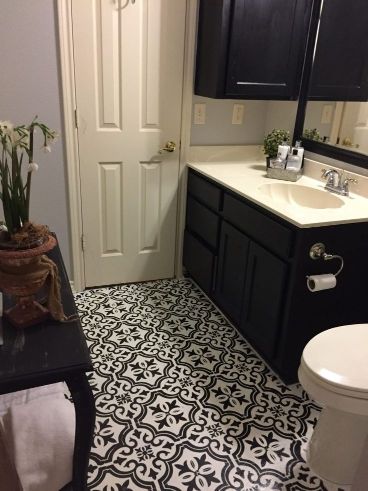 How to update and old vinyl floor with chalk paint to look like tile. In my post I'll share tips and tricks that I used to update my old floor using a stencil and chalkpaint in a few easy steps. Painted floor/chalk paint floors/ update a vinyl floor/ how to stencil a bathroom floor