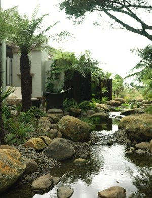 New Zealand's Luxury Kauri Cliffs Spa. The Spa River winds through the property, relaxing your senses as you enjoy the private spa patio.