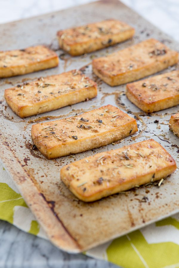 baked italian herb tofu2 tablespoons liquid aminos (I used coconut aminos) 1 tablespoon light olive oil 1 tablespoon water 1 teaspoon red wine vinegar 1 1/2 teaspoons garlic powder 1/2 teaspoon dried basil 1/2 teaspoon dried rosemary 1/2 teaspoon dried oregano A dash of freshly ground black pepper 1 (15-ounce) package extra-firm tofu, pressed for 30 minutes and cut into 8 slabs Salt to taste