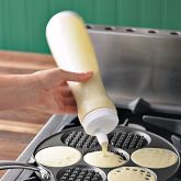 Waffles...TWO GREAT IDEAS!  (1)  A different kind of pan to cook them in (the oven) and (2) a great way to store and dispense the batter.  Neat!
