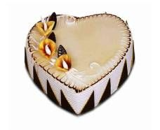Love You Forever, Heart shaped cake topped with flowers and whipped in cream. Order now!