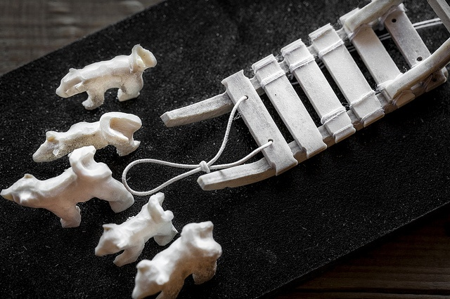 handicraft of greenlandic sled and dogs of bone by Kristian Skifte