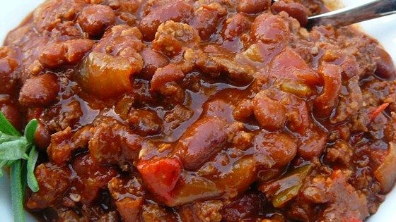 Ground beef, Italian sausage, beans, and a tomato base come together with lots of flavor and spice in this popular chili recipe. It's perfect for tailgating before football games or any time of year.