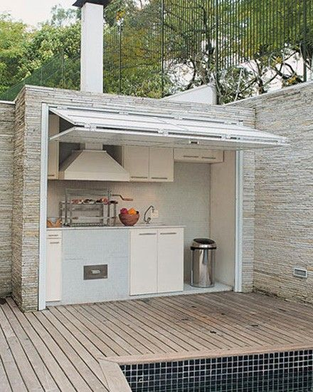 An outdoor kitchen. Love that this can be tucked away when not in use.
