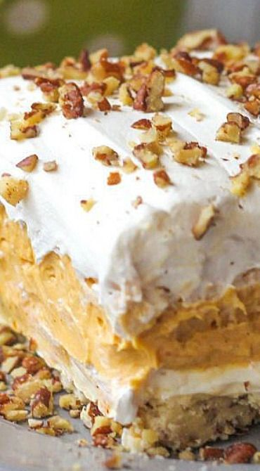 Layered Pumpkin Dessert ~ a pecan layer, cream cheese layer, pumpkin and pudding layer and a Cool Whip layer on top