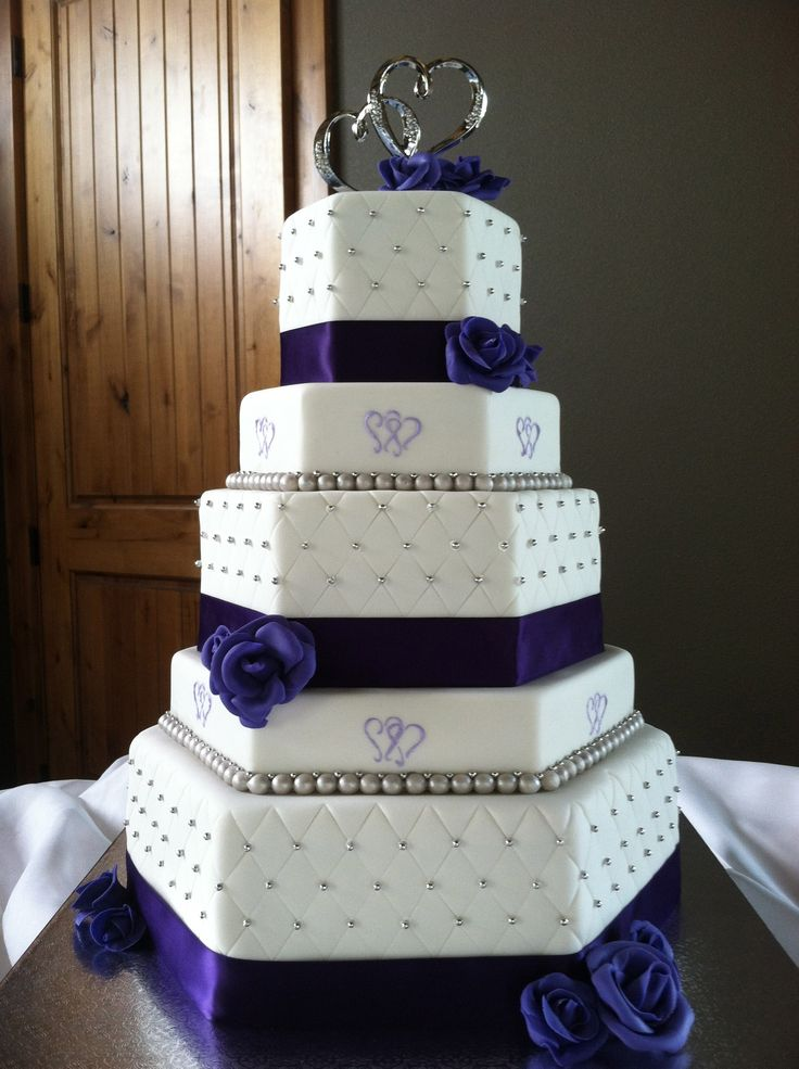 Two hearts themed purple and silver hexagon wedding cake - The photo looks navy blue but the cake was actually deep purple and silver, this was my first time making gumpaste roses, using the quilting technique, and doing a hexagon shaped cake!  It was a learning curve for sure but I am happy with the overall result.  Thanks for looking!