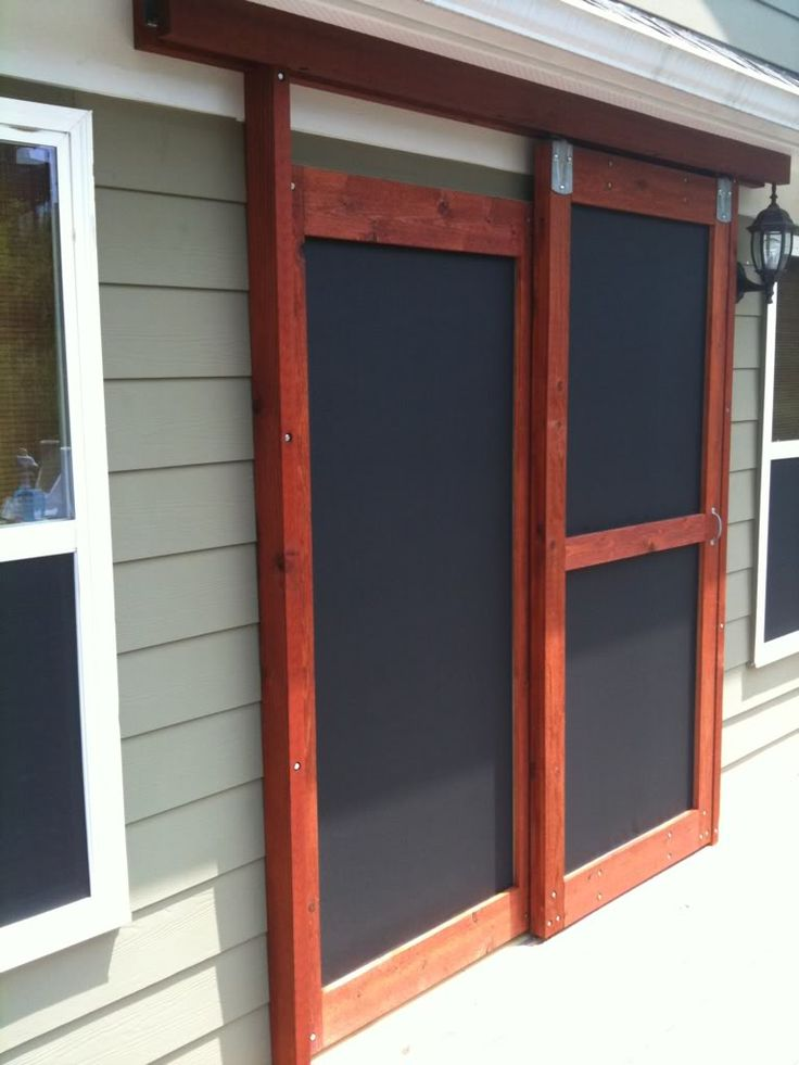 Movable doors built a sliding screen door the garage for Double sliding screen door