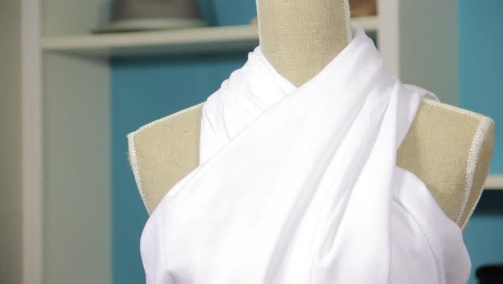 Wrapping a two-shoulder toga is something that you do by just wrapping it around yourself. Wrap a two-shoulder toga with help from an expert who has been in the communications and fashion Industry for...