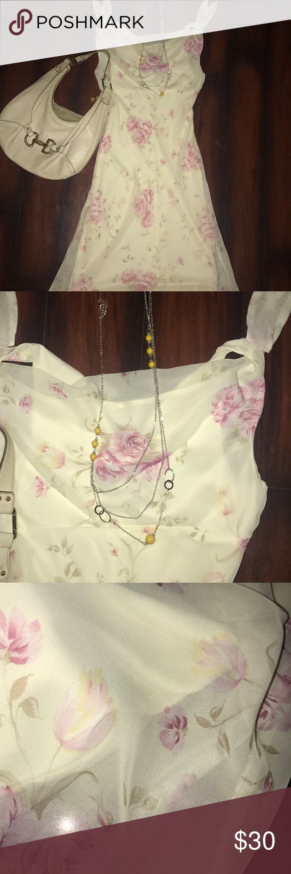 Fabulous Easter Dress Beautiful light yellow dress with pink flowers. This dress is gorgeous on!!! Sheer on top with solid lining. Necklace and earrings included!!  Outfit is perfect for Easter or Sunday brunch! Dresses Midi