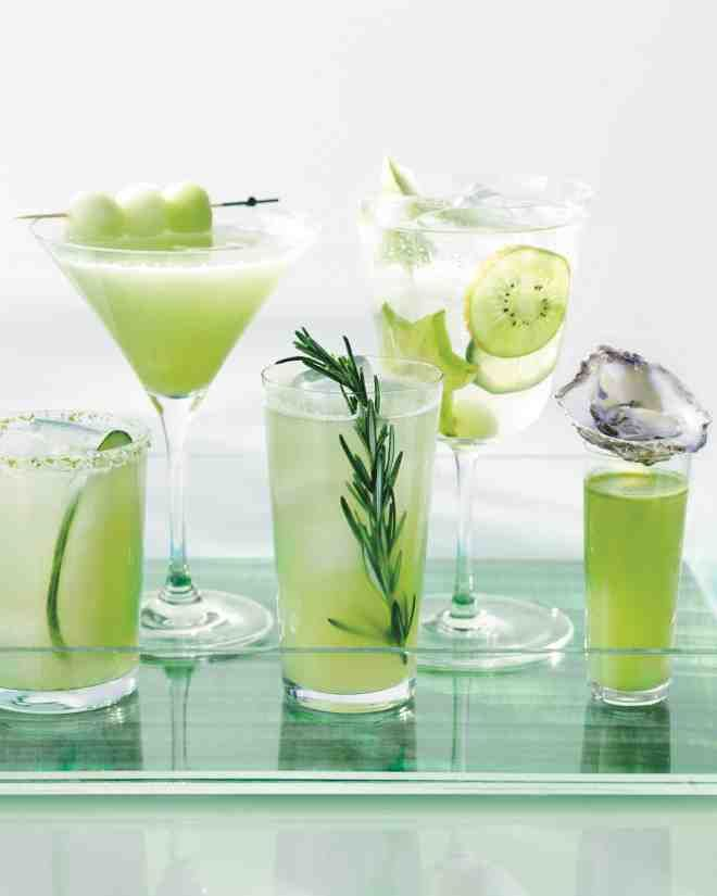 To make this snazzy drinks tray, cut the decal to size, stick it to the bottom of a tray, and voilà! Next, add signature drinks that play up the palette. Cucumber purée gives the Stealth Margarita its hue. White rum, basil simple syrup, and honeydew melon liven up the Garden Daiquiri. This Apple and Rosemary Fizz puts a nonalcoholic spin on the real thing. Garnish Sangria Blanco with slices of star fruit, kiwi, green apple, lime, and whole grapes. An Oyster Shooter gets a kick from Agua…