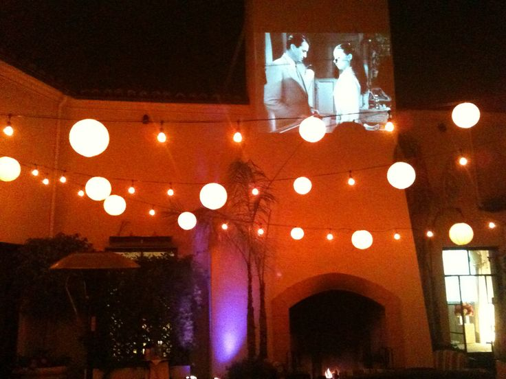 Stunning The bride wanted her favorite movie projected on the wall of the patio at the Bel Air Bay Club in Los Angeles for her wedding reception