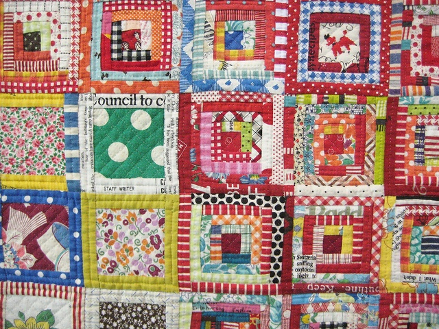 Bright and scrappy log cabin quilt