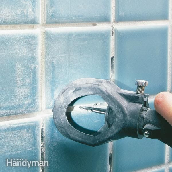 Replace grungy, eroded grout in your shower. Simplify the tough grout removal part with an inexpensive power grinder. It speeds up the job so you can move on the easier parts, regrouting and polishing the tile.