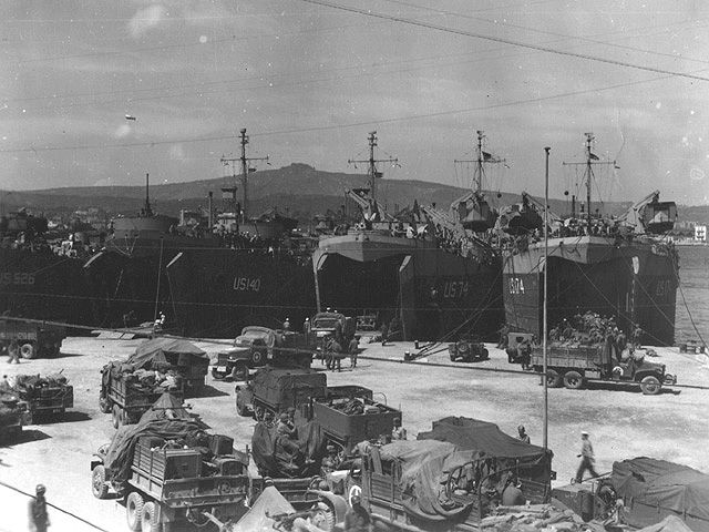 LSTs line the docks in Naples for the 3rd, 45th and 36th Division for Operation Dragoon
